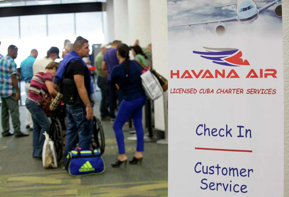 Travelers line up to check in for charter flights from Miami to Havana at Miami International Airport, Friday, Jan. 16, 2015 in Miami. Following through on its declaration of warming ties with Cuba, the Obama administration has eased travel restrictions and opened a wide range of new export opportunities with the communist island.  (AP Photo/Wilfredo Lee) Photo: Wilfredo Lee, STF / AP