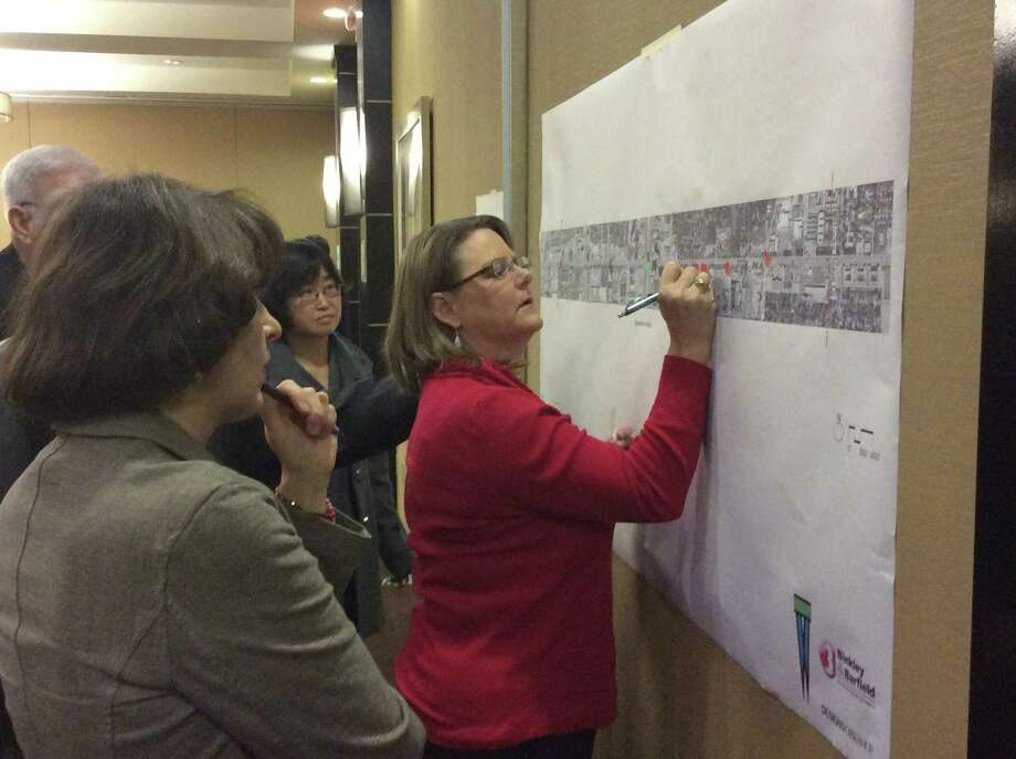 Westchase area resident Karen Rhoden identifies mobility challenges on Westheimer as Cheryl Gajeske (in foreground) and Sherry Cang look on during a process to re-design a portion of the corridor in the Westchase District. Photo: Robin Foster / ONLINE_YES