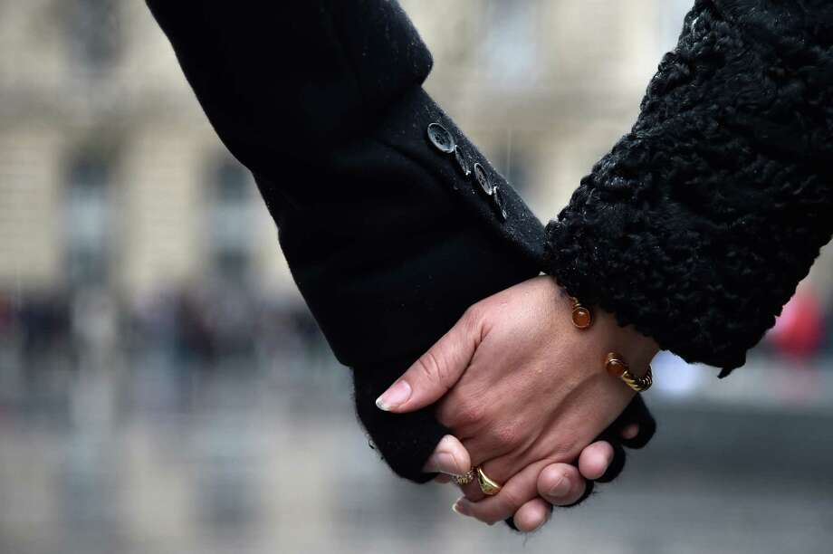 People hold hands and form a circle around the Place de la Republique in solidarity with the victims of the recent terrorist attack at the offices of the French satirical publication Charlie Hebdo in Paris. In the aftermath of the shootings, a reader says we must always remember how precious the right to freedom of speech is. Photo: Pascal Le Segretain /Getty Images / 2015 Getty Images