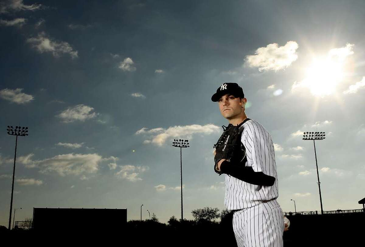 TAMPA, FL - FEBRUARY 25: (EDITOR'S NOTE: IMAGE HAS BEEN DIGITALLY DESATURATED) David Robertson #30 of the New York Yankees poses for a photo during Spring Training Media Photo Day at George M. Steinbrenner Field on February 25, 2010 in Tampa, Florida. (Photo by Nick Laham/Getty Images) *** Local Caption *** David Robertson
