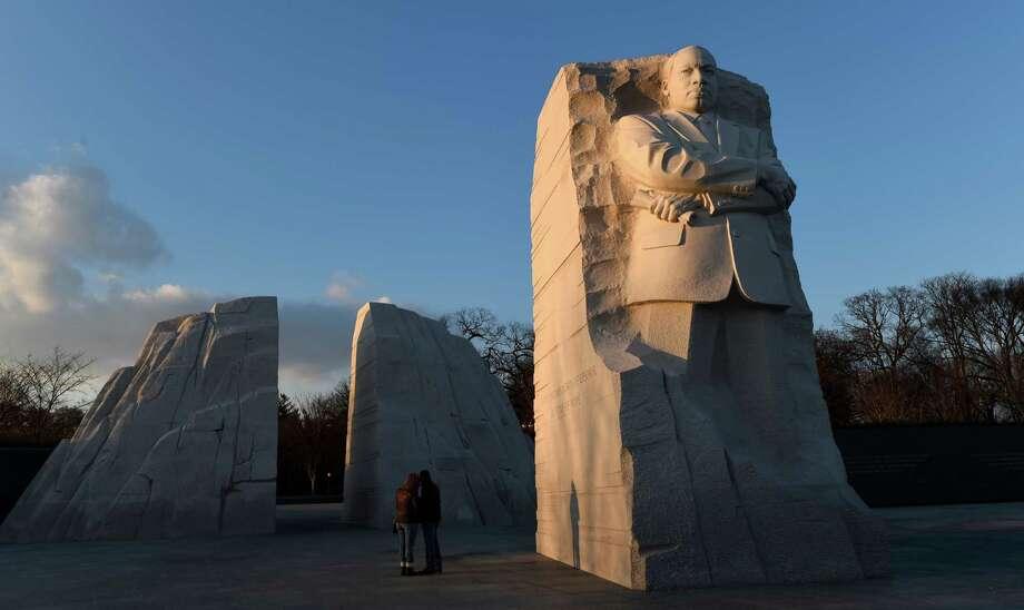 People visit the Martin Luther King Memorial in Washington, Friday, Jan. 16, 2015. (AP Photo/Susan Walsh) Photo: Susan Walsh, STF / AP