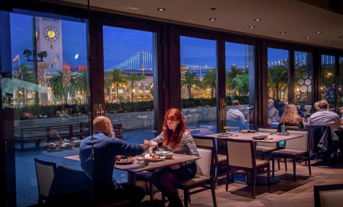 The Bay Bridge and Ferry Building set the scene for Crystal Jade's 20,000-square-foot space.