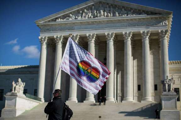 Pete Prete with Equality Beyond Gender waves a flag in support of gay marriage in front of the U.S. Supreme Court in Washington, Jan. 16, 2015. The court had agreed to decide whether all 50 states must allow gay and lesbian couples to marry. The court's announcement made it likely that it would resolve one of the great civil rights questions of the age before its current term ends in June. (Jabin Botsford/The New York Times)