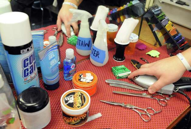 Student Jose Martizez's styling table during a free designer haircuts day at the Austin's School of Spa Technology on Friday, Jan. 16, 2015, in Albany, N.Y. (Michael P. Farrell/Times Union) Photo: Michael P. Farrell / 00030217A