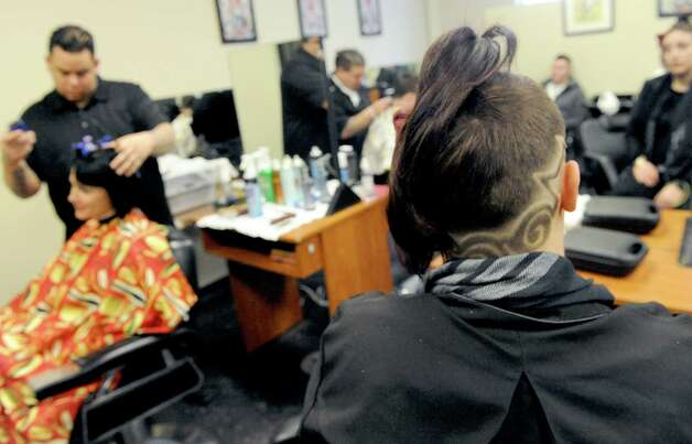 Student Alica Sheroka, right, sports a new hair style  during a free designer haircuts day at the Austin's School of Spa Technology on Friday, Jan. 16, 2015, in Albany, N.Y. (Michael P. Farrell/Times Union) Photo: Michael P. Farrell / 00030217A
