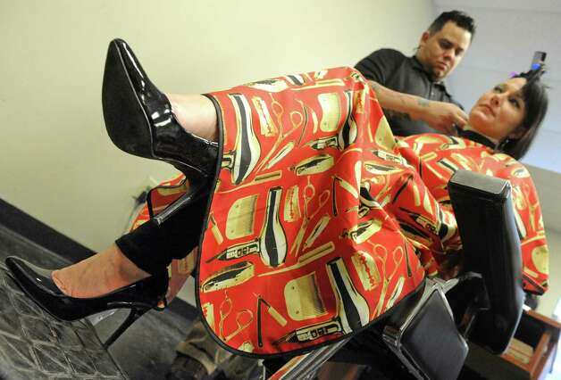 Barber Battle champion and instructor, Immanuel Bonilla styles the hair of Leigh Ann Shields during a free designer haircuts day at the Austin's School of Spa Technology on Friday, Jan. 16, 2015, in Albany, N.Y. (Michael P. Farrell/Times Union) Photo: Michael P. Farrell / 00030217A