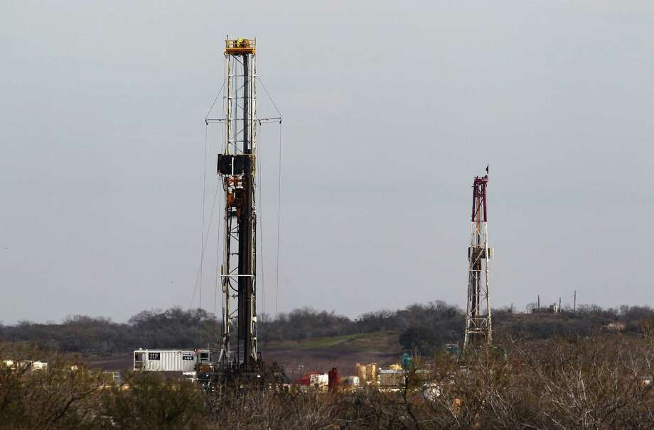 A pair of oil rigs are seen near Karnes City. Karnes County is considered the heart of the field — it produces more oil than any other spot in Texas. Photo: Express-News File Photo / ©2015 San Antonio Express-News