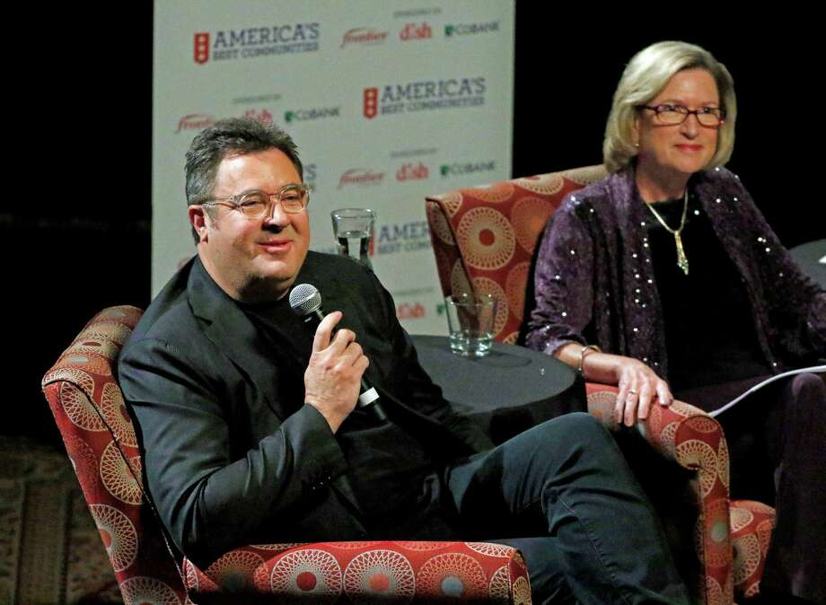 Country music great Vince Gill chats with Maggie Wilderotter, Chairman and CEO of Frontier Communications in Stamford, at the Country Music Hall of Fame in Nashville last week. Photo: Contributed Photo / Greenwich Time Contributed