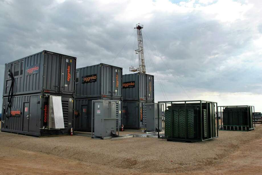 The temporary-power company Aggreko has been working with an Eagle Ford Shale producer to capture gas that would otherwise be flared and use it to create electricity. Here are Aggreko power generators operating on stranded gas in South Texas. Photo: Courtesy Photo