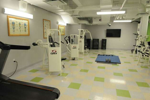 A exercise room at the new men's residence of the YMCA on Friday, Jan. 16, 2015, on Broadway in Schenectady, N.Y. The new facility was built to house homeless people who used to live at the YMCA?s now-closed facility on State Street. (Michael P. Farrell/Times Union) Photo: Michael P. Farrell / 00030148A