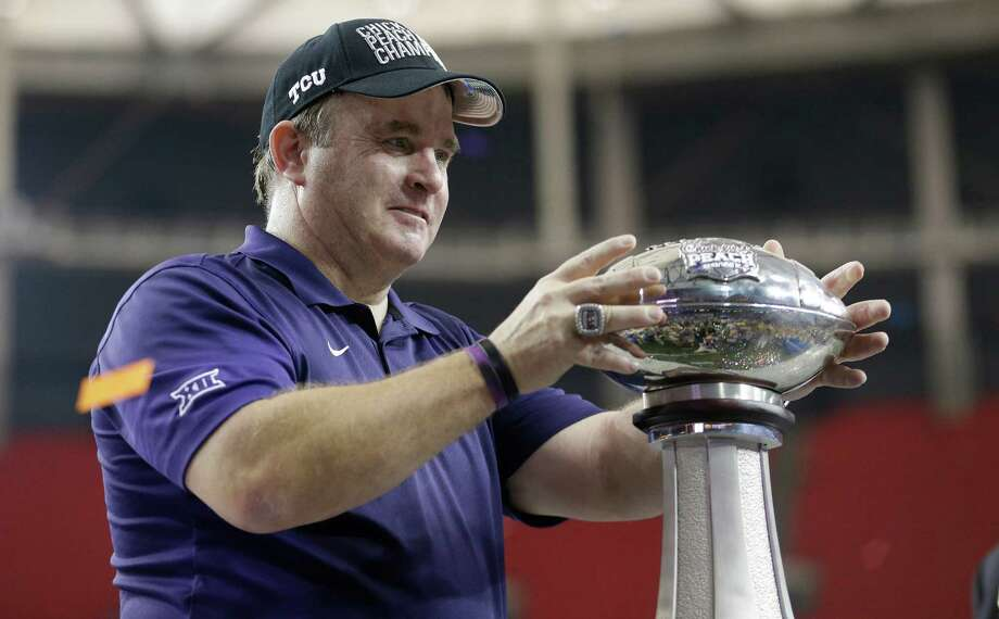 TCU head coach Gary Patterson holds the Peach Bowl trophy after the second half of the Peach Bowl NCAA football game against Mississippi, Wednesday, Dec. 31, 2014, in Atlanta. TCU won 42-3. (AP Photo/David Goldman) Photo: David Goldman, STF / Associated Press / AP