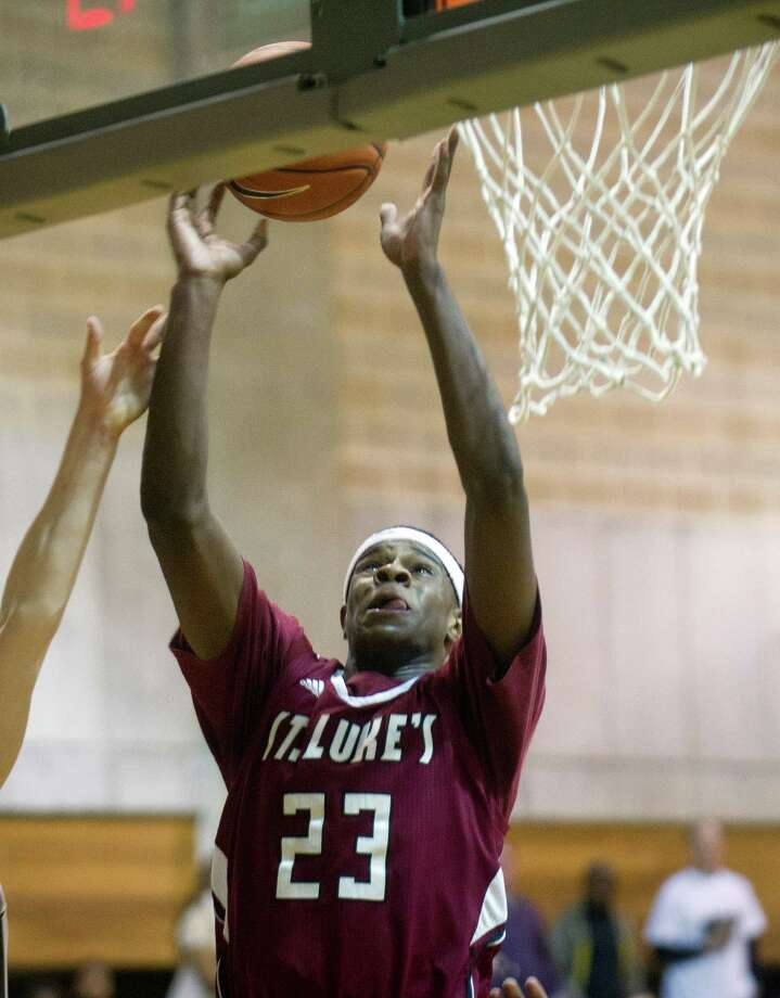 St. Luke's Walter Whyte takes a shot during Friday's basketball game at Brunswick in Greenwich, Conn., on January 16, 2015. Photo: Lindsay Perry / Stamford Advocate