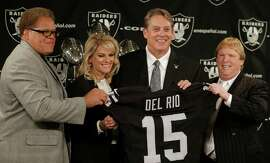 From left, Raiders general manager Reggie McKenzie, Linda Del Rio, head coach Jack Del Rio and owner Mark Davis pose after the new coach's introductory news conference in Alameda on Friday.
