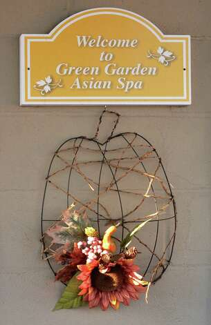 Sign at the entrance to Green Garden Asian Spa on Central Avenue Friday Jan. 16, 2015, in Colonie, NY.  (John Carl D'Annibale / Times Union) Photo: John Carl D'Annibale / 00030248B
