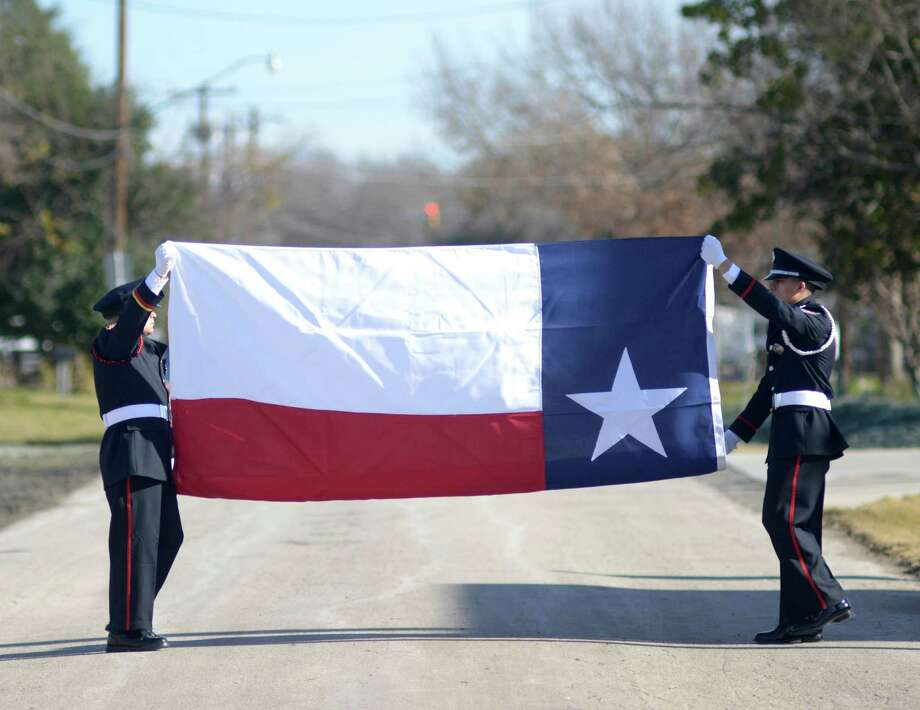 Members of the Leon Valley Fire Department Honor Guard prepare for the dedication ceremony. Photo: Billy Calzada /San Antonio Express-News / San Antonio Express-News