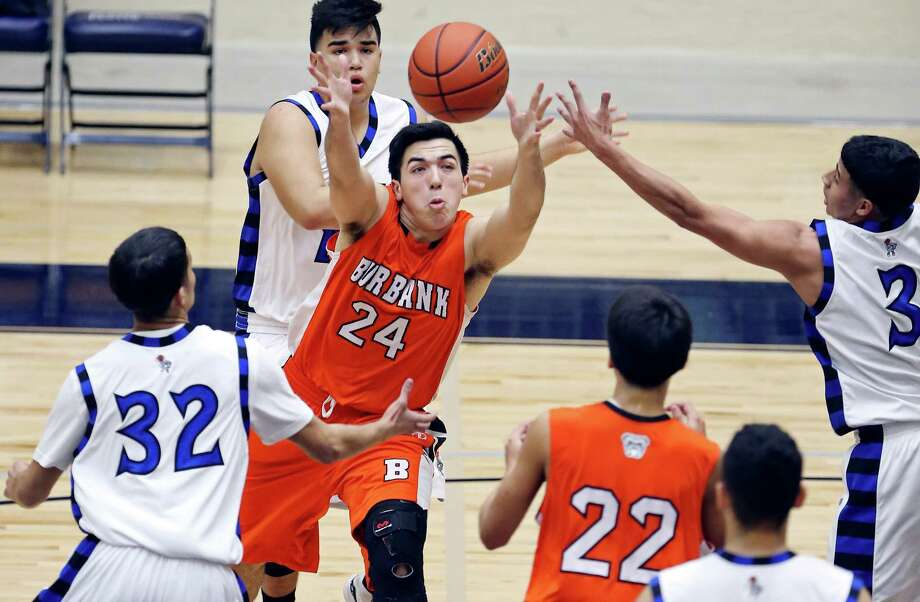 Burbank's  Michael Mascorro grabs for a rebound between Lanier's Israel Serna (left) and Brian Laque during first half action Friday Jan. 16, 2015 at Alamo Convocation Center. Photo: Edward A. Ornelas, Staff / San Antonio Express-News / © 2015 San Antonio Express-News