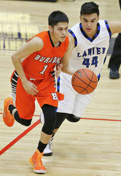 Burbank's Juan Castillo drives around Lanier's Raul Solis  during first half action Friday Jan. 16, 2015 at Alamo Convocation Center. Photo: Edward A. Ornelas, Staff / San Antonio Express-News / © 2015 San Antonio Express-News