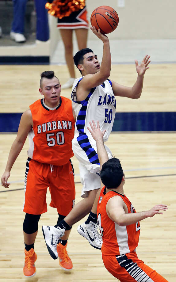 Lanier's Jerry Samudio shoots between Burbank's William Valdez (left) and Michael Mascorro during first half action Friday Jan. 16, 2015 at Alamo Convocation Center. Photo: Edward A. Ornelas, Staff / San Antonio Express-News / © 2015 San Antonio Express-News