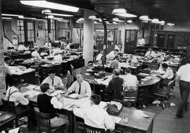 The Chronicle's City Room circa 1960 around 8 p.m., shortly after the first edition went out.