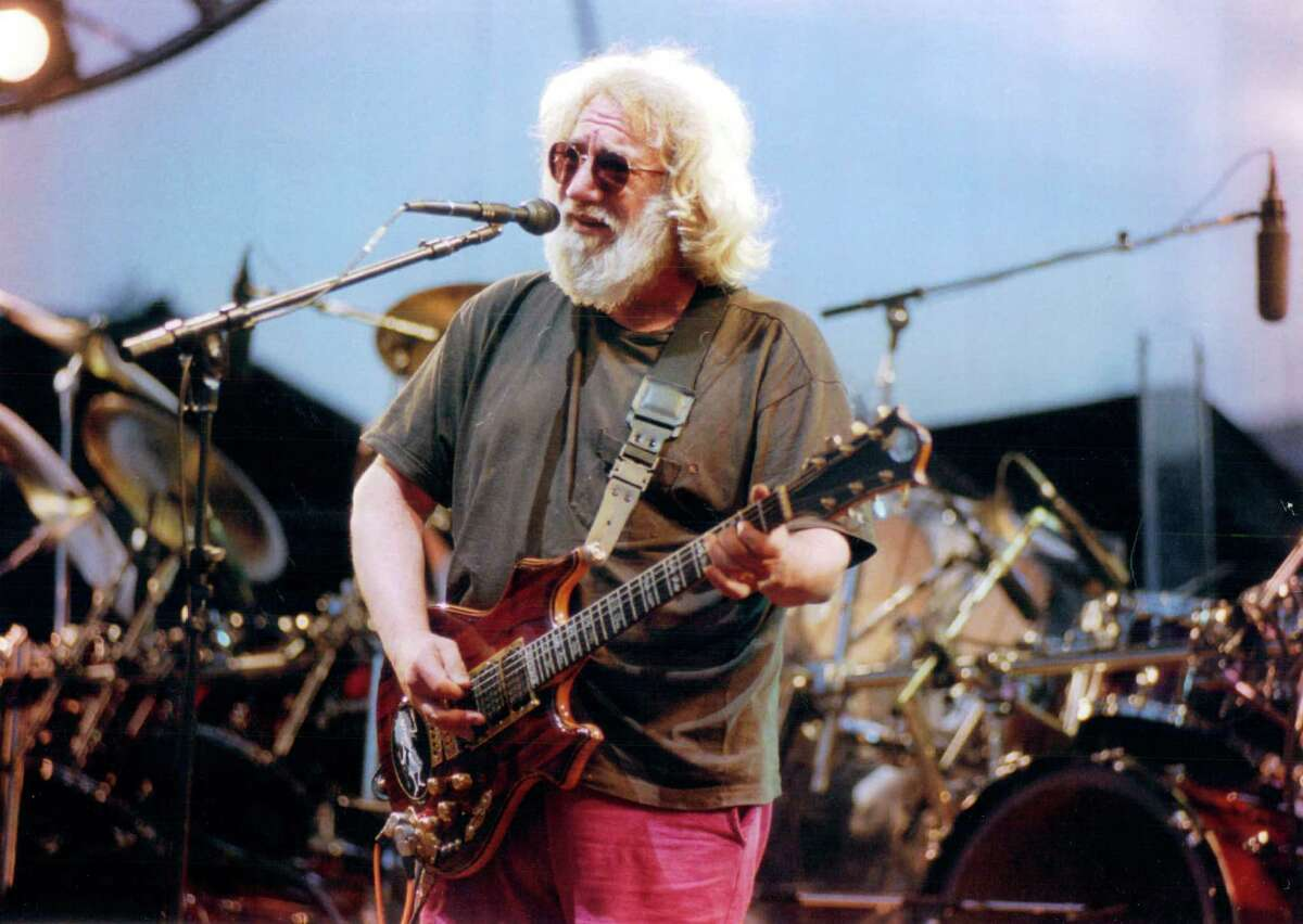 The Grateful Dead's final shows with Jerry Garcia, above, were in July 1995 at Chicago's Soldier Field. Surviving band members will return there in July.NO SALES, NO INTERNET - The Grateful Dead, with singer Jerry Garcia, play Chicago's Soldier Field, July 8, 1995. (Tribune photo/Jose M. Osorio)