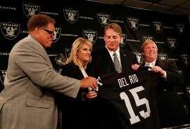 Raiders GM Reggie McKenzie (left) and owner Mark Davis (right) flank Linda Del Rio and new head coach Jack Del Rio.