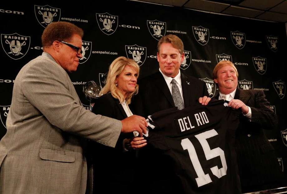 Raiders GM Reggie McKenzie (left) and owner Mark Davis (right) flank Linda Del Rio and new head coach Jack Del Rio. Photo: Leah Millis / The Chronicle / ONLINE_YES
