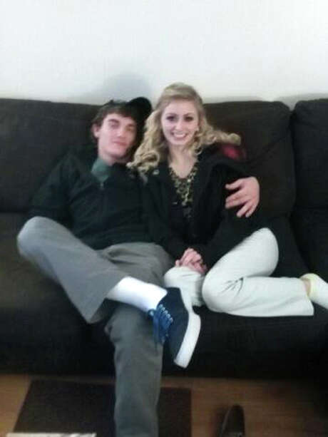 In this December 2014 photo provided by Tammy Martin, her son Dalton Hayes, 18, snuggles with his 13-year-old girlfriend, Cheyenne Phillips, at his family's home in Leitchfield, Ky. Hayes, 18, and Phillips, 13, who vanished nearly two weeks ago, are suspected in a multistate crime spree that have police desperately searching for the couple. Authorities believe the couple has traveled to South Carolina and Georgia. Along the way, they're suspected of stealing multiple vehicles and using stolen checks, law enforcement officials said. (AP Photo/Tammy Martin) Photo: Tammy Martin /Associated Press / Tammy Martin