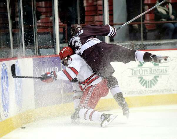 RPI's Viktor Liljegren, left, and Colgate's Brendan Corcoran slam into the boards during their hockey game on Friday, Jan. 16, 2015, at Houston Field House in Troy, N.Y. (Cindy Schultz / Times Union) Photo: Cindy Schultz / 00030185A