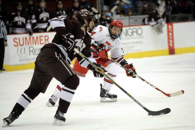 RPI's Riley Bourbonnais, right, defends as Colgate's Jake Kulevich moves the puck during their hockey game on Friday, Jan. 16, 2015, at Houston Field House in Troy, N.Y. (Cindy Schultz / Times Union) Photo: Cindy Schultz / 00030185A