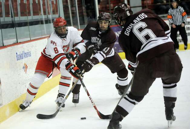 RPI's Kenny Gillespie, left, battles for a loose puck against Colgate's Jake Kulevich, center, and Spiro Goulakos during their hockey game on Friday, Jan. 16, 2015, at Houston Field House in Troy, N.Y. (Cindy Schultz / Times Union) Photo: Cindy Schultz / 00030185A