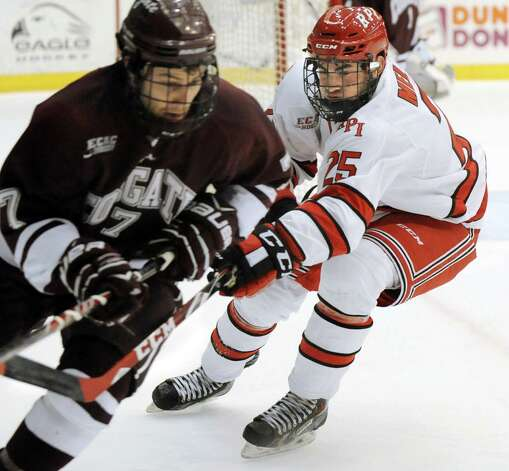 RPI's Drew Melanson, right, tries to slow down Colgate's Ryan Johnston during their hockey game on Friday, Jan. 16, 2015, at Houston Field House in Troy, N.Y. (Cindy Schultz / Times Union) Photo: Cindy Schultz / 00030185A