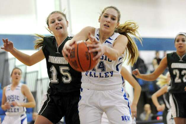 Greenwich's Isabelle Kuzmich, left, and Hoosic Valley's L'Rae Brundige, center, battle for a rebound during their basketball game on Friday, Jan. 16, 2015, at Hoosic Valley High in Schaghticoke, N.Y. (Cindy Schultz / Times Union) Photo: Cindy Schultz / 00030214A