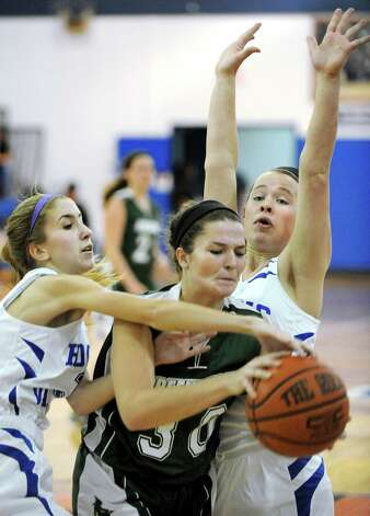 Greenwich's Gabrielle VanDeWater, center, battles for a rebound with Hoosic Valley's Cami Hren, left, and Daniella Requate during their basketball game on Friday, Jan. 16, 2015, at Hoosic Valley High in Schaghticoke, N.Y. (Cindy Schultz / Times Union) Photo: Cindy Schultz / 00030214A