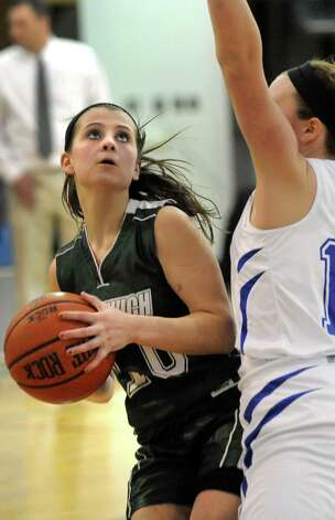 Greenwich's Alexis Case moves in on the hoop as Hoosic Valley's Daniella Requate defends during their basketball game on Friday, Jan. 16, 2015, at Hoosic Valley High in Schaghticoke, N.Y. (Cindy Schultz / Times Union) Photo: Cindy Schultz / 00030214A