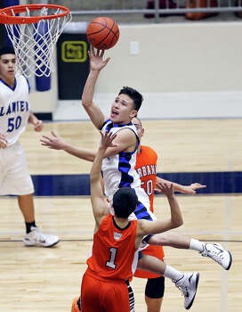 Lanier's Joe Soto shoots over Burbank's Juan Castillo during second half action Friday Jan. 16, 2015 at Alamo Convocation Center. Soto was fouled on the play. Lanier won 57-45. Photo: Edward A. Ornelas, San Antonio Express-News / © 2015 San Antonio Express-News