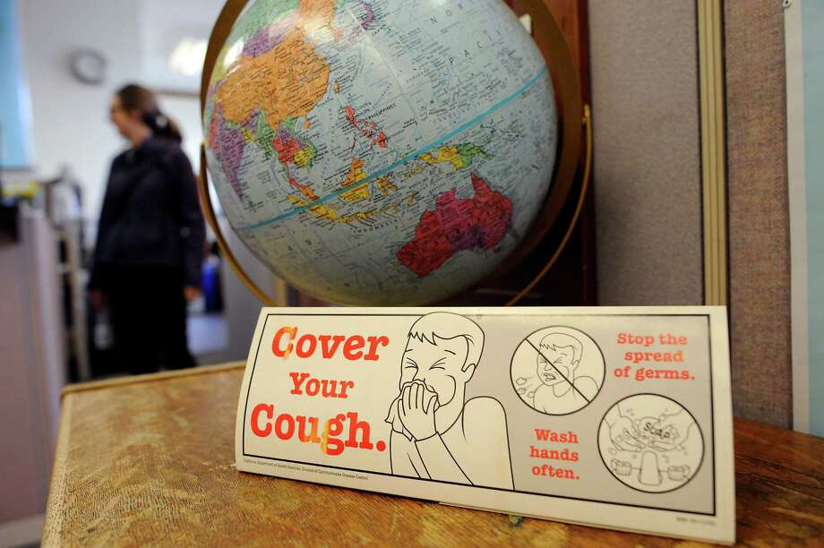 A sign informs patients about the spread of germs at the San Francisco Public Health Department offices in San Francisco, CA, on Friday, January 16, 2015. Photo: Michael Short / Special To The Chronicle / ONLINE_YES