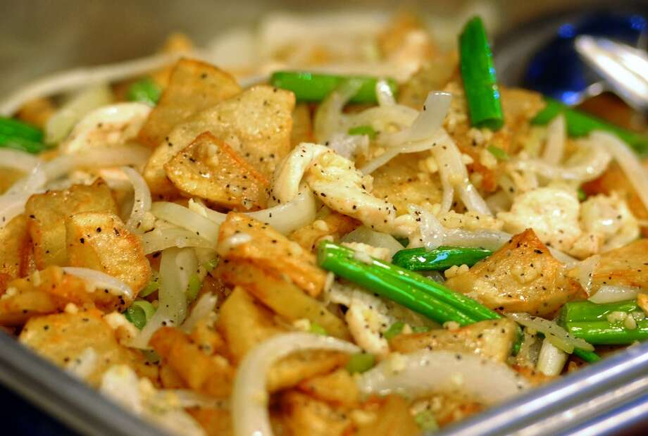 Chicken and potatoes at the Taste of China Express in Beaumont. The newly opened restaurant offers cafeteria style Chinese food and features other menu items.  Photo taken Monday, January 05, 2015 Guiseppe Barranco/The Enterprise Photo: Guiseppe Barranco/The Enterprise