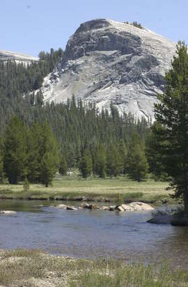 Lembert Dome and the Tuolomne River are part of the scenery in Tuolumne Meadows at Yosemite National Park.