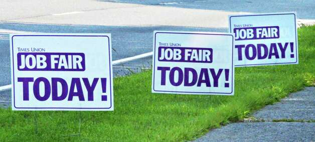 Placards advitise the Times Union Job Fair at the Albany Marriott Wednesday July 23, 2014, in Colonie, NY.  (John Carl D'Annibale / Times Union) Photo: John Carl D'Annibale / 00027884A