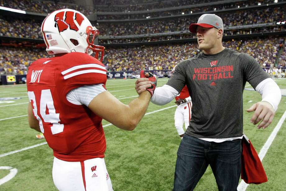 Texans star J.J. Watt shakes hands with his brother Derek before Wisconsin's game against LSU on Aug. 30, 2014 at NRG Stadium. Photo: J. Patric Schneider, For The Chronicle / © 2014 Houston Chronicle