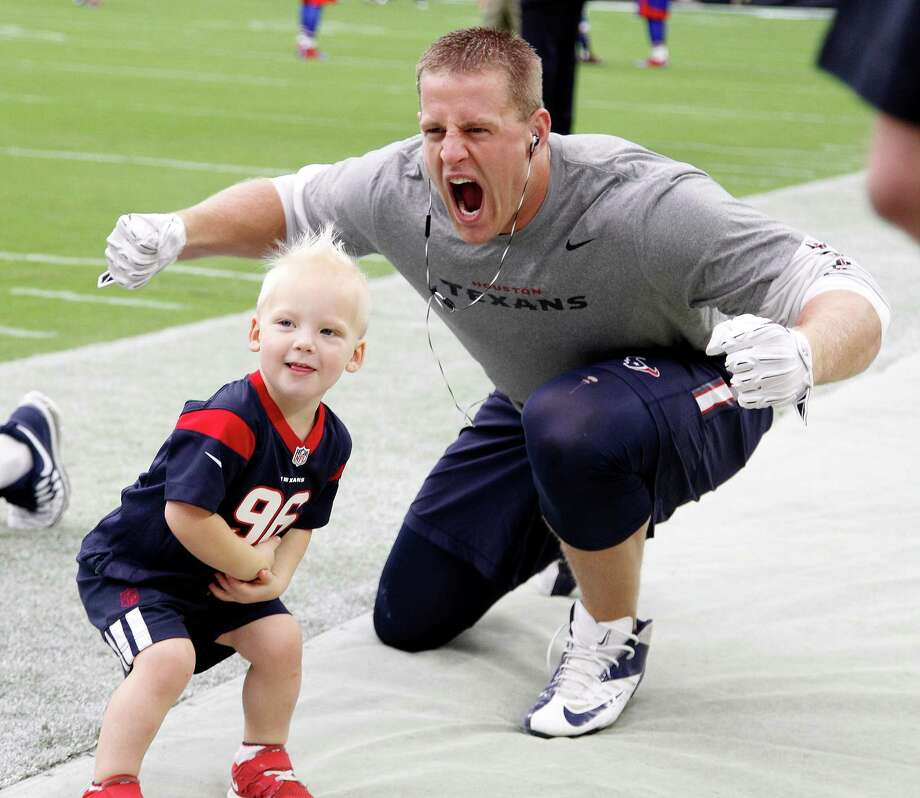 Houston Texans defensive end J.J. Watt photo bombs Calhoun McNair, 2, who is the son of Cal McNair on the field before the start of an NFL football game at NRG Stadium, Sunday, Sept. 28, 2014, in Houston. Photo: Karen Warren, Houston Chronicle / © 2014 Houston Chronicle