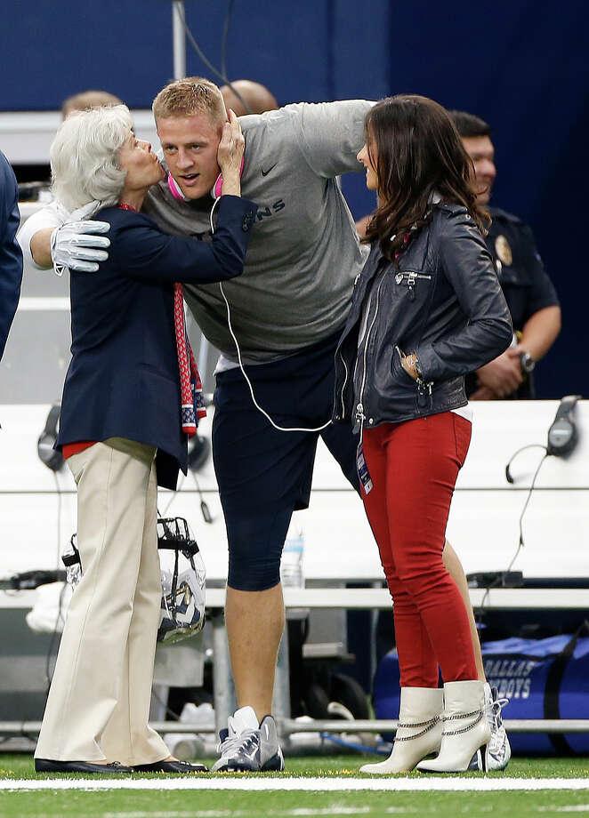 Houston texans defensive end j j watt gets a kiss from janice mcnair
