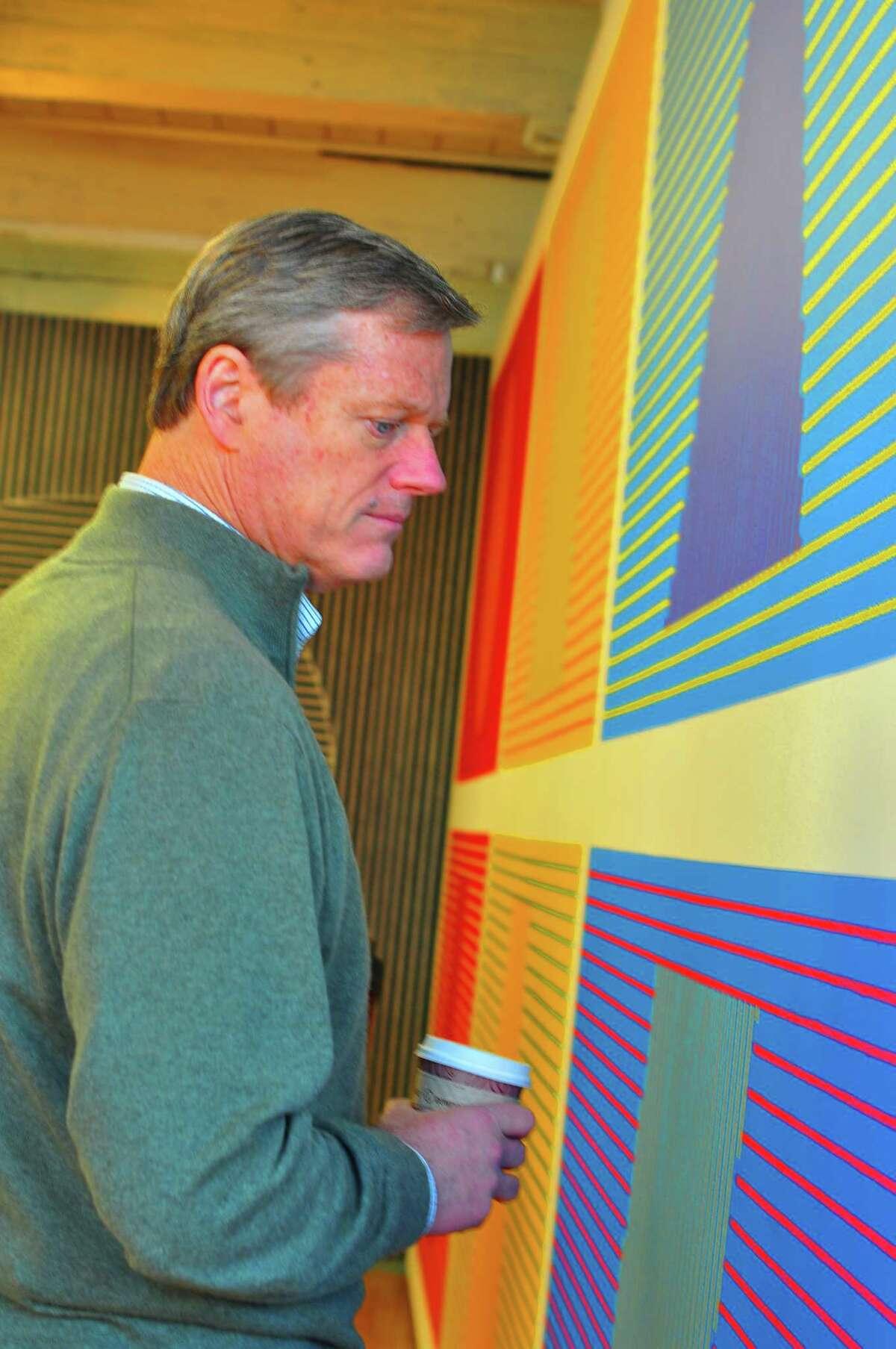 Massachusetts Gov. Charlie Baker looks at part of the exhibit