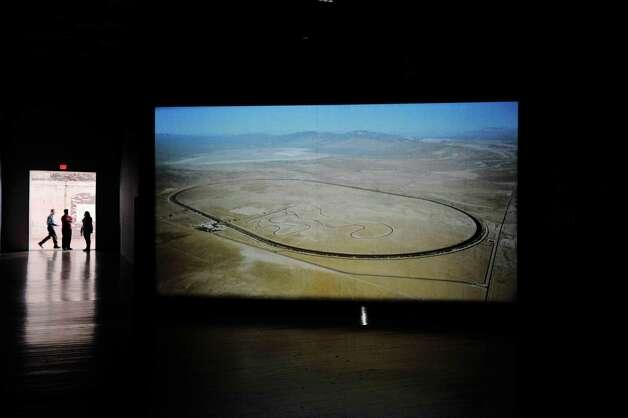"A film by Rodney Graham titled ""Torqued Chandelier Release,"" plays on a screen inside Mass MoCA on Wednesday, Jan. 14, 2015, in North Adams, Mass.  (Paul Buckowski / Times Union) Photo: Paul Buckowski / 00030194A"