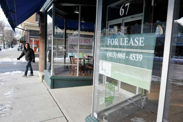 A for lease sign is seen in the window of a commercial space on Main St. in the downtown district on Wednesday, Jan. 14, 2015, in North Adams, Mass.  (Paul Buckowski / Times Union) Photo: Paul Buckowski / 00030194A
