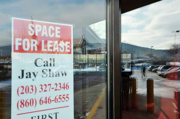 A for lease sign is seen in the window of an empty commercial space on Main St.  in the downtown district on Wednesday, Jan. 14, 2015, in North Adams, Mass.  (Paul Buckowski / Times Union) Photo: Paul Buckowski / 00030194A