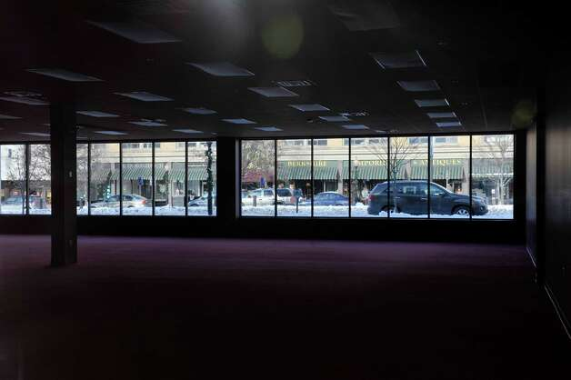 Main St. in seen through the windows of a large empty commercial space in the downtown district on Wednesday, Jan. 14, 2015, in North Adams, Mass.  (Paul Buckowski / Times Union) Photo: Paul Buckowski / 00030194A