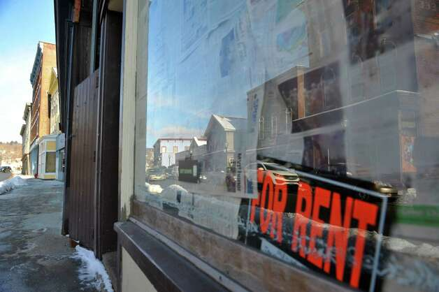 A for rent sign in the window of an empty commercial space on Eagle St. in the downtown district on Wednesday, Jan. 14, 2015, in North Adams, Mass.  (Paul Buckowski / Times Union) Photo: Paul Buckowski / 00030194A