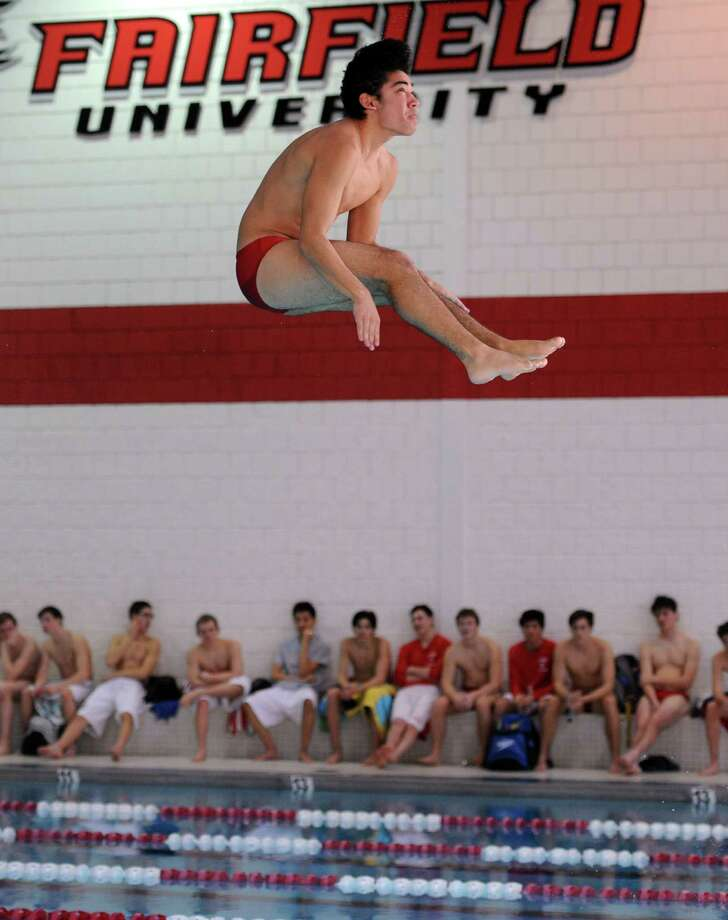 Fairfield Prep diver Mike Connolly competes during a meet with Greenwich Saturday, Jan. 17, 2015, at the Fairfield University Rec Plex pool. Photo: Autumn Driscoll / Connecticut Post