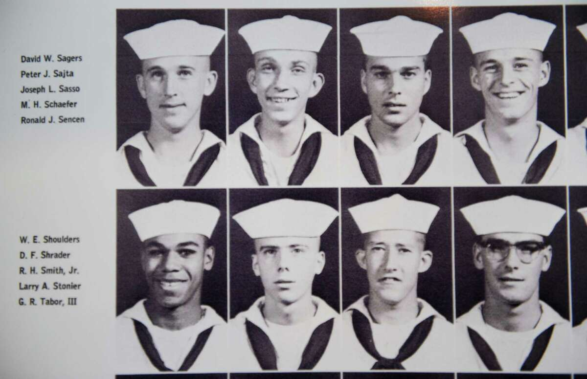 Photo of Navy Vietnam veteran Peter Sajta, top row, second from left, from a yearbook type photo book on Thursday, Jan. 15, 2015 in Hagaman, N.Y. Sajta would be eligible for more home improvement money from the VA if it rated his disabilities higher. (Lori Van Buren / Times Union)